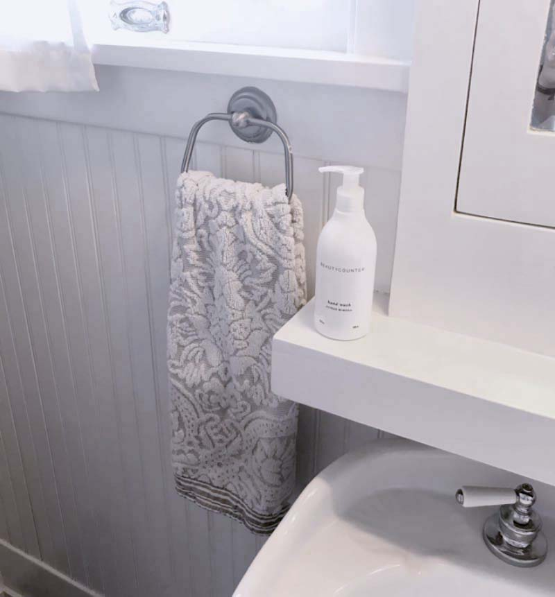Bathroom with towel and lotion prepared for an open house