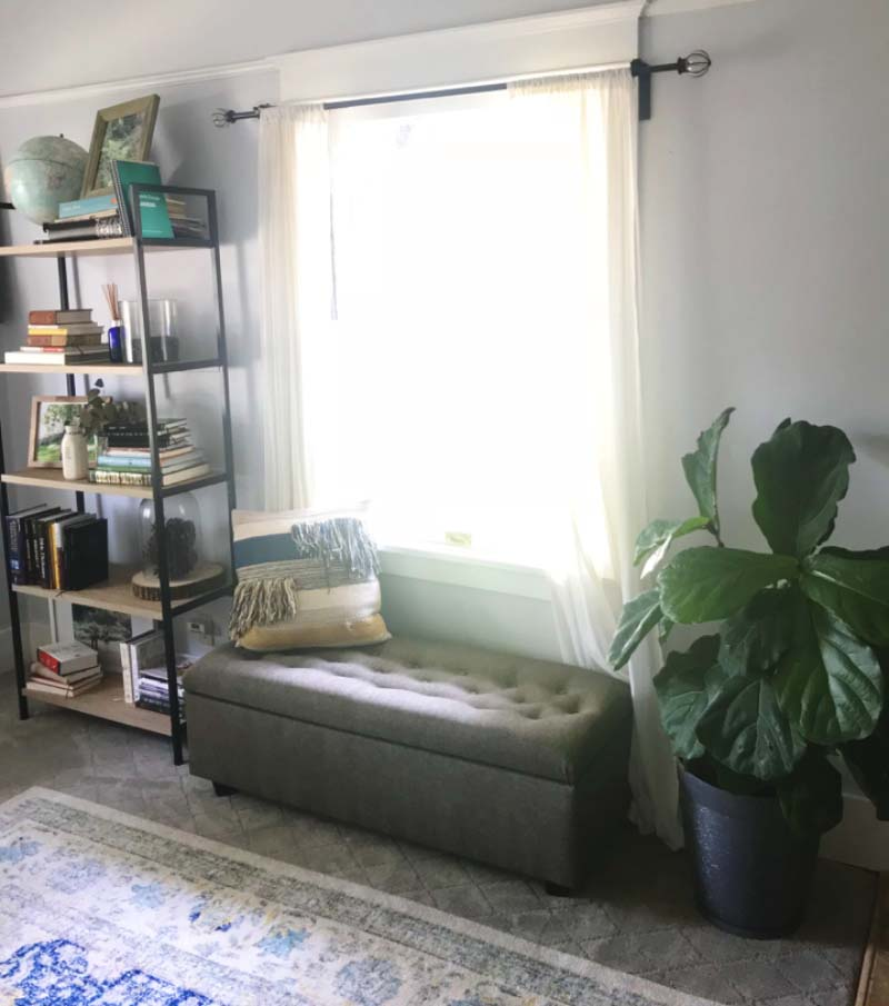 Window with a bench and shelves organized when preparing for an open house