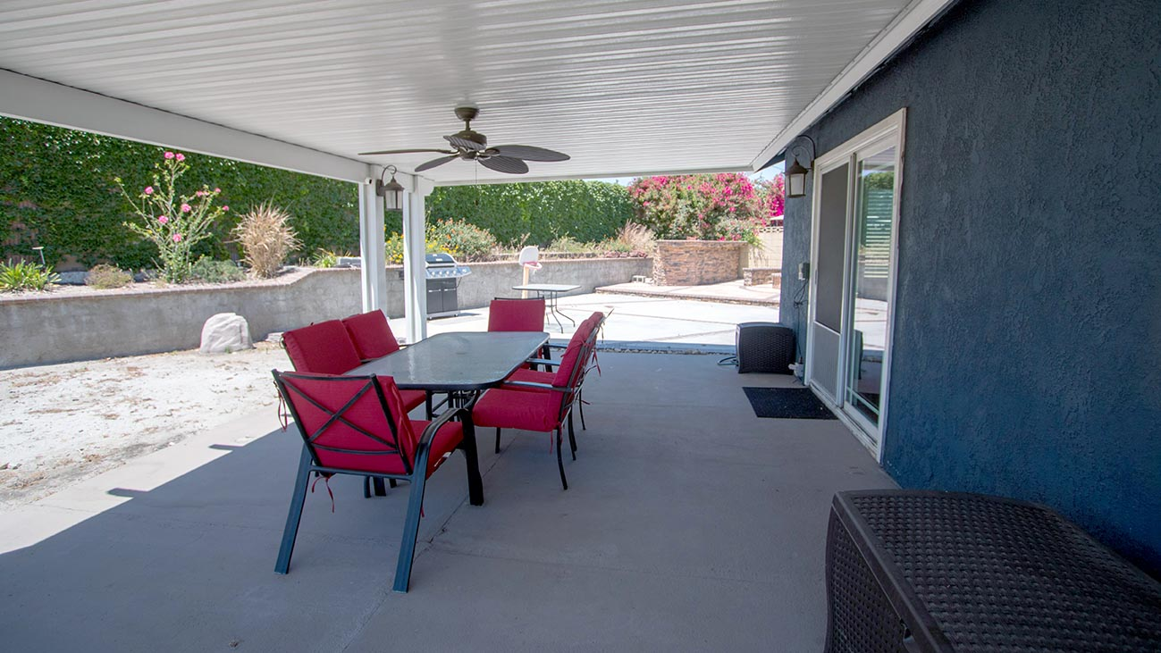 Covered outdoor patio with lighting & ceiling fan